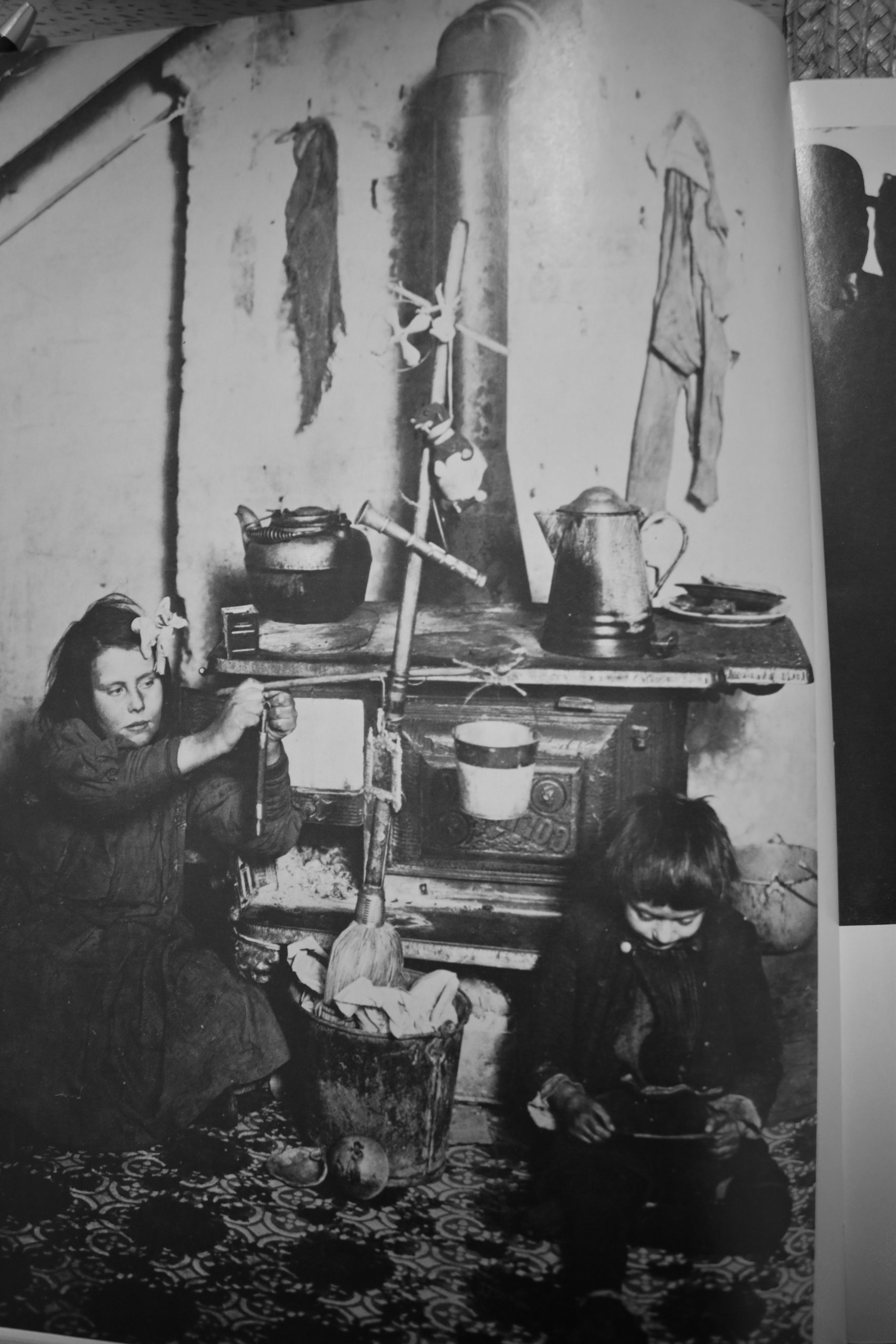 NEW YORK STREET KIDS--Courtesy of Children's Aid Society: Two children making a Christmas Tree out of a broom