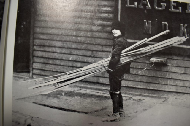 NEW YORK STREET KIDS--Courtesy of Children's Aid Society: Boy fetching firewood for the family stove