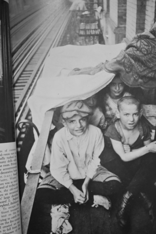 NEW YORK STREET KIDS--Courtesy of The Children's Aid Society: Kids try to escape sweltering heat by sleeping on the fire escape